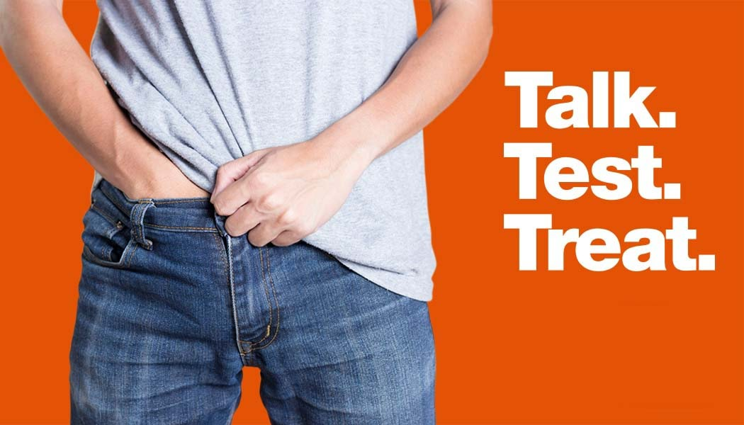 Image Man putting a hand inside with pants, next to the words 'Talk. Test. Treat.'