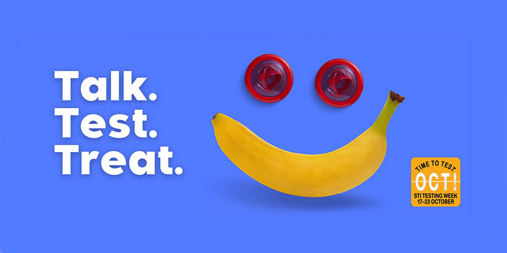 STI testing week 17-23 October - Time to test Oct!  Logo says Talk.Test.Treat. Image of 2 red condoms and a banana